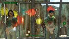 Marcy and Jun testing the stationary paintball gun.